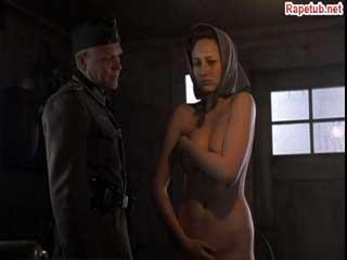 Фашист заставляет девушку раздеться догола и осматривает ее.